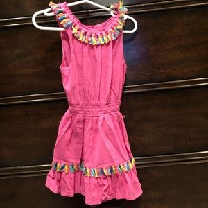 Flapdoodles pink dress with tassel accents.